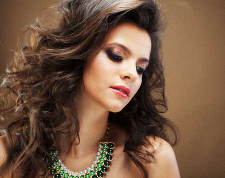 Beaity and fashion concept: Brunette woman with long, healthy and shiny curly hair.Young model woman with wavy hairstyle .