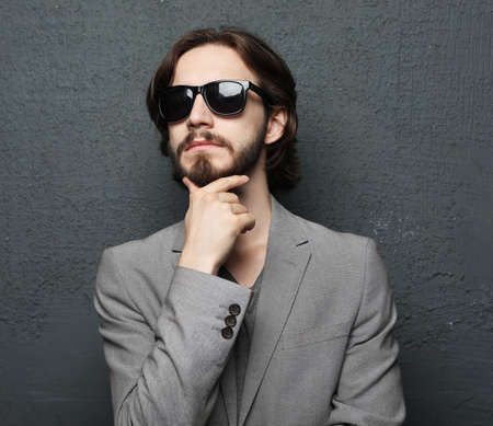Portrait of a young handsome man wearing sunglasses