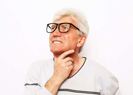 Old senior grandpa having terrible sore throat. Portrait of man suffering from sore throat. White isolated background.
