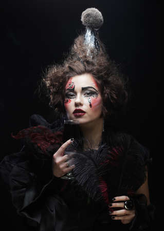 Young woman with gothic make-up and crazy hair-style. Creative fashion masquerade. Party time.