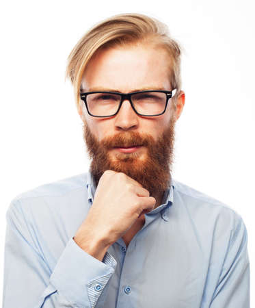 Handsome bearded guy in glasses and blue shirt over white background