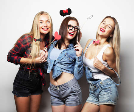 Stylish hipster girls best friends ready for party.