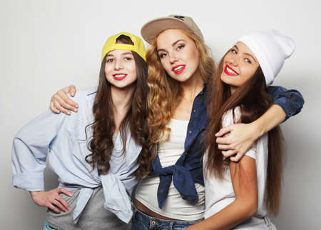 Three young girl friends standing together and having fun.