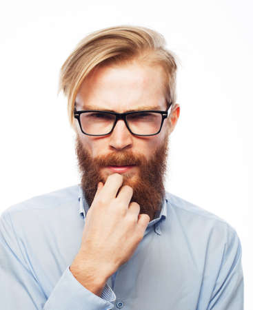 Young handsome thinking man with red hair, wearng glasses Stockfoto