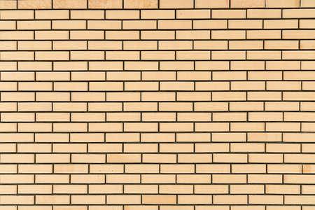 Yellow brick wall vintage background. New brick wall texture