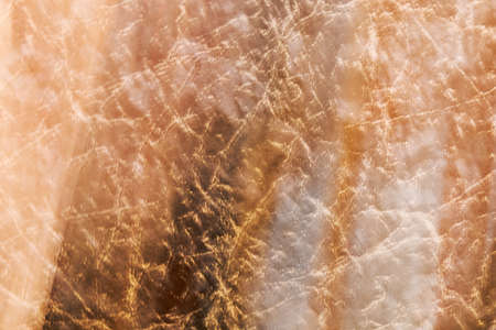 Abstract light brown divorced texture. Beautiful light brown texture with stains, abstract surface background