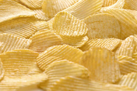Image of sliced potato chips. Bunch of crisps. Closeup. Background.