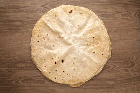Pita bread on wooden background. Pita bread. National cuisine.