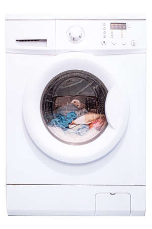 Laundry in a washing machine. Automatic washing machine. Isolate on a white background. Front view