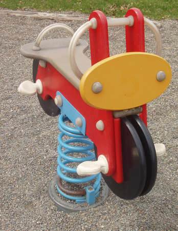 back and forth: Spring toy that child goes back and forth on