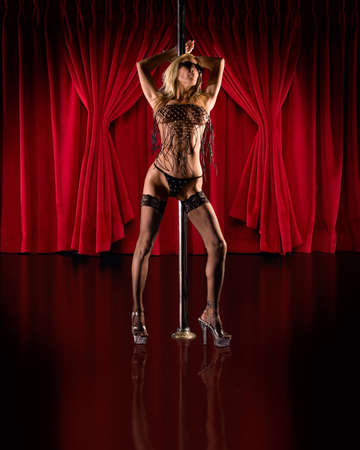 stripper pole: Exotic pole dancer posed on stage