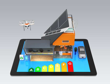 Smart house on a tablet PC isolated on gray background, with energy rating chart. Stock Photo