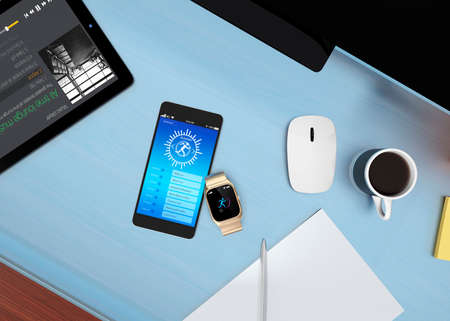 synchronizing: Smart watch synchronizing fitness app with smart phone on table.