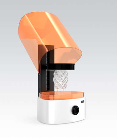 solidify: Opened SLA  3D printer with printed model on the stage.