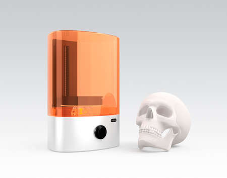 solidify: SLA  3D printer and plastic skull model isolated on gray background.