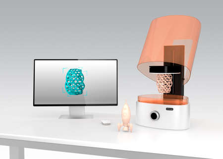 rapid prototyping: SLA  3D printer and monitor which displaying  model  on the screen.