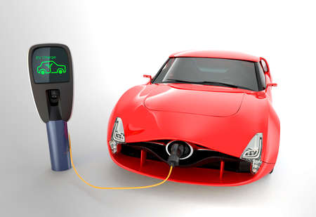electric station: Red electric sports car charging in charging station.