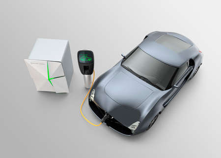 electric system: Electric car charging in EV charging station. The charging station power supply by battery storage system.