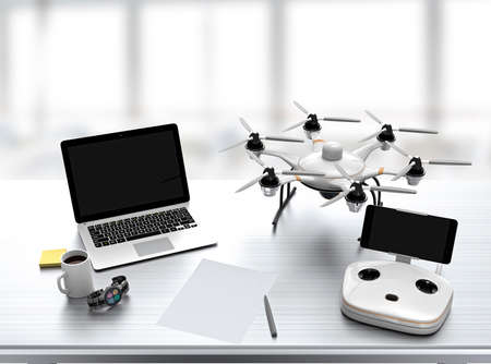 Hexacopter remote controller laptop on desk with office interior background Standard-Bild