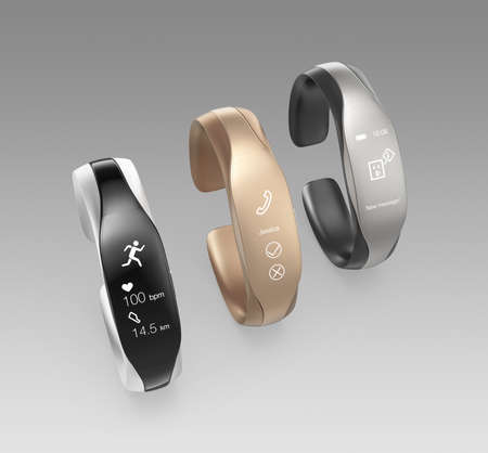heart monitor: Stylish smart bands isolated on gray background. Stock Photo