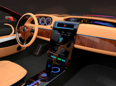 Stylish electric car interior with luxury wood pattern decoration. User using touch screen to do some setup work. Original design. Stock Photo
