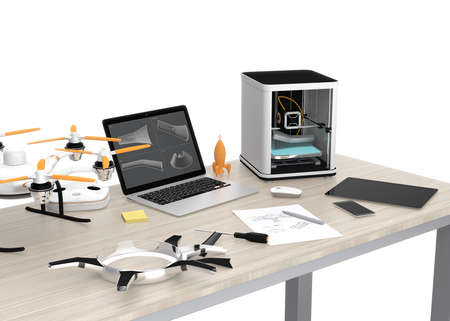 3D printer, laptop, tablet PC and drone on a table, concept for new technology for DIY. Archivio Fotografico