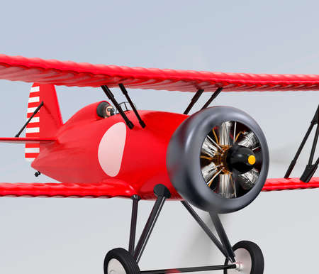 fixed wing aircraft: Close up view of red biplane flying in the sky.