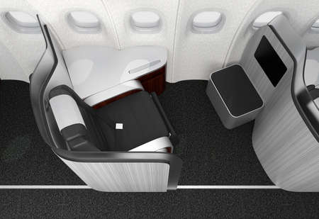 Close-up of luxurious business class seat with frosted acrylic partition. 3D rendering image in original design. Stock Photo