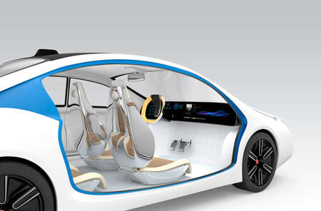 seat: Autonomous cars interior concept. The car offer folding steering wheel, rotatable passenger seat. Original design. Clipping path available. Stock Photo