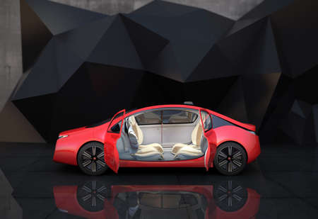 Side view of red autonomous car in front of geometric object background