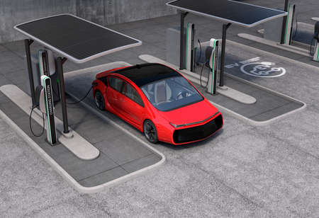 Electric vehicle charging station in public space. The charging spot support by solar panels, storage batteries.