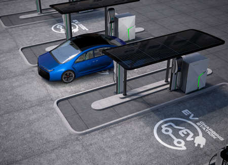 electricity grid: Electric vehicle charging station in public space. The charging spot support by solar panels, storage batteries.