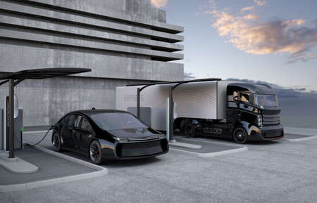 Hybrid electric truck and white electric car in charging station 스톡 콘텐츠