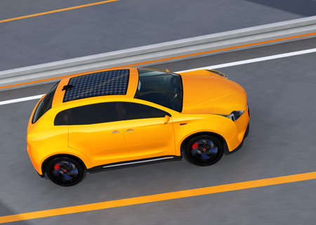 zero emission: Yellow electric SUV with solar panel on the roof driving on highway. 3D rendering image. Stock Photo