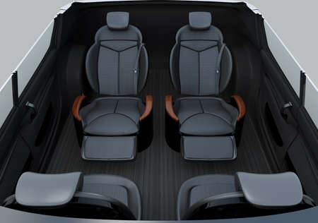 Front view of self-driving car cutaway image. Front seats turn to backward, and the rear seats have gorgeous reclining massage function. 3D rendering image. Stock Photo