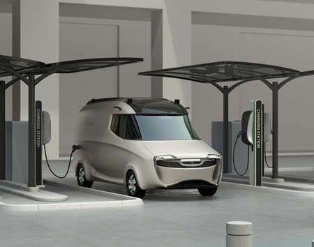 electric station: Delivery van in charging station. The charging station installed with solar panels. 3D rendering image. Stock Photo