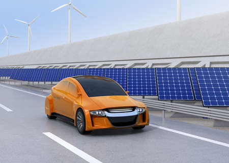 Electric car driving on the wireless charging lane of the highway.  Solar panel station and wind turbine on the roadside. 3D rendering image. Imagens
