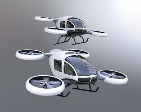 Two self-driving passenger drones flying in the sky. 3D rendering image. 스톡 콘텐츠