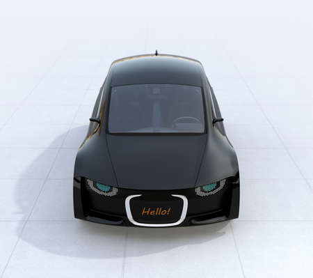 Black self-driving car's front grille showing digital signage for pedestrian. Concept for communication between autonomous car and pedestrian. 3D rendering image. 写真素材