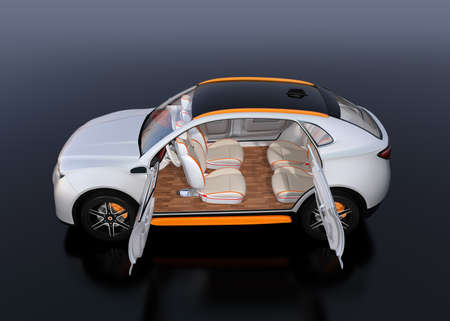 Side view of white self-driving Electric SUV car on reflective ground. Front seats turned backward. 3D rendering image. 写真素材