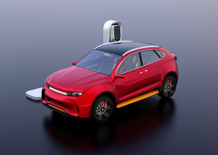Red electric SUV car charging in charging station. 3D rendering image. Stock Photo