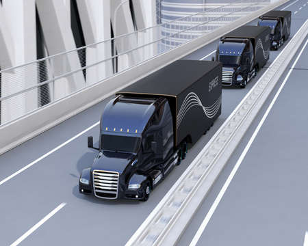 A fleet of black self-driving Fuel Cell Powered American Trucks driving on highway. 3D rendering image. 写真素材