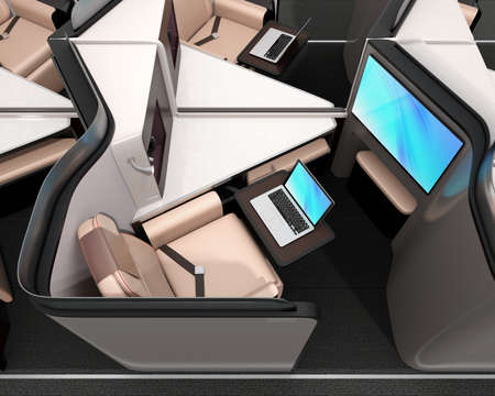 Side view of luxury business class suite. Laptop on the table connected to the monitor on partition by Wi-Fi. 3D rendering image. Stock Photo