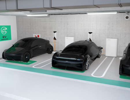 Black electric cars charging in charging station locate in underground  parking lot. 3D rendering image. Banque d'images