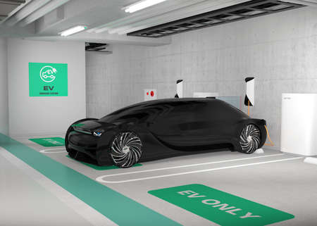 Black electric car charging in charging station locate in underground  parking lot. 3D rendering image. Stock Photo