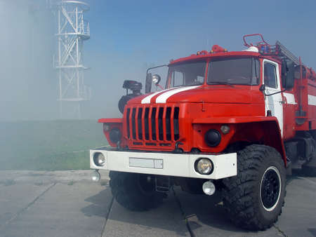 explosion engine: red with white fire engine in the smoke