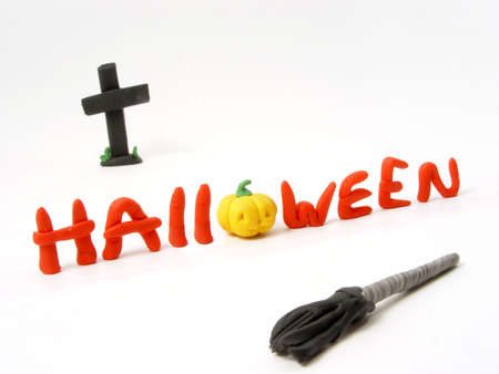 Halloween insrcription from the plasticine with cross and broom photo