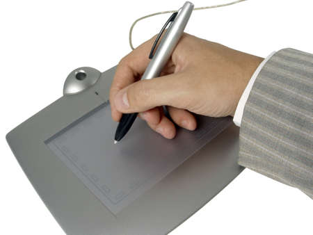 hand holding pen: businessman hand holding pen over the tablet Stock Photo