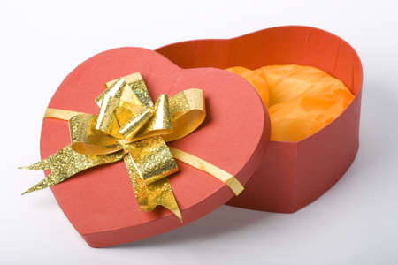 isolated opened heart shape box with gold bow Stock Photo - 2506518