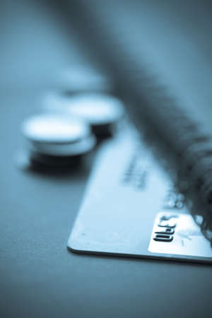credit card finance concept with coins Stock Photo